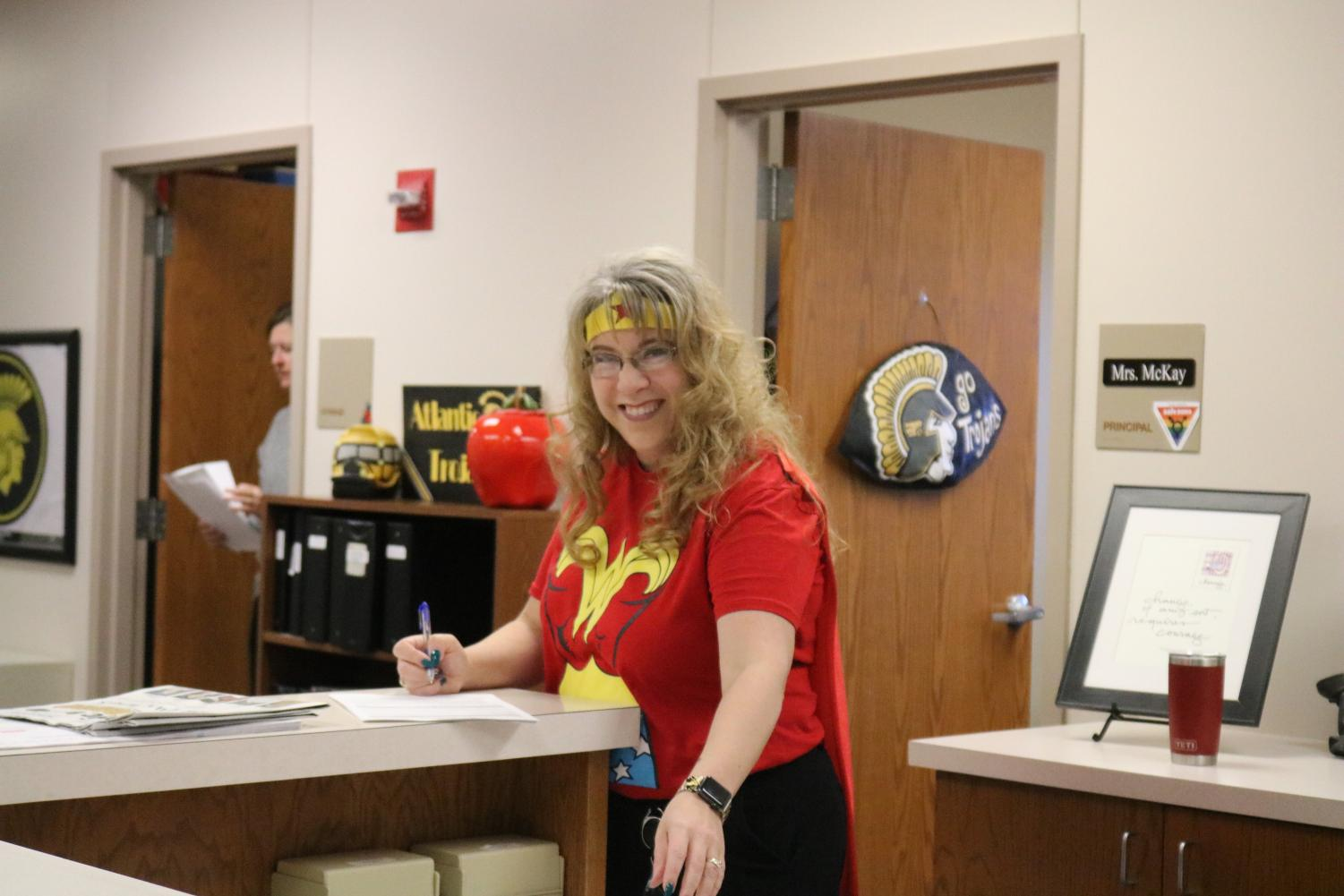 WONDER WOMAN --  Principal Heather McKay wears a cape to complete her Wonder Woman costume. McKay's love for Wonder Woman doesn't stop at her attire. Artwork and knick knacks of the superhero can be found all over her office.