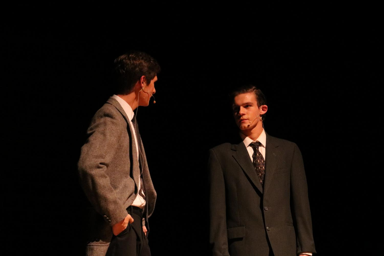 Seniors Zach McKay and Bradley Dennis have a heated conversation towards the end of the show. Both boys played associates of the U.S. Radium Corporation.
