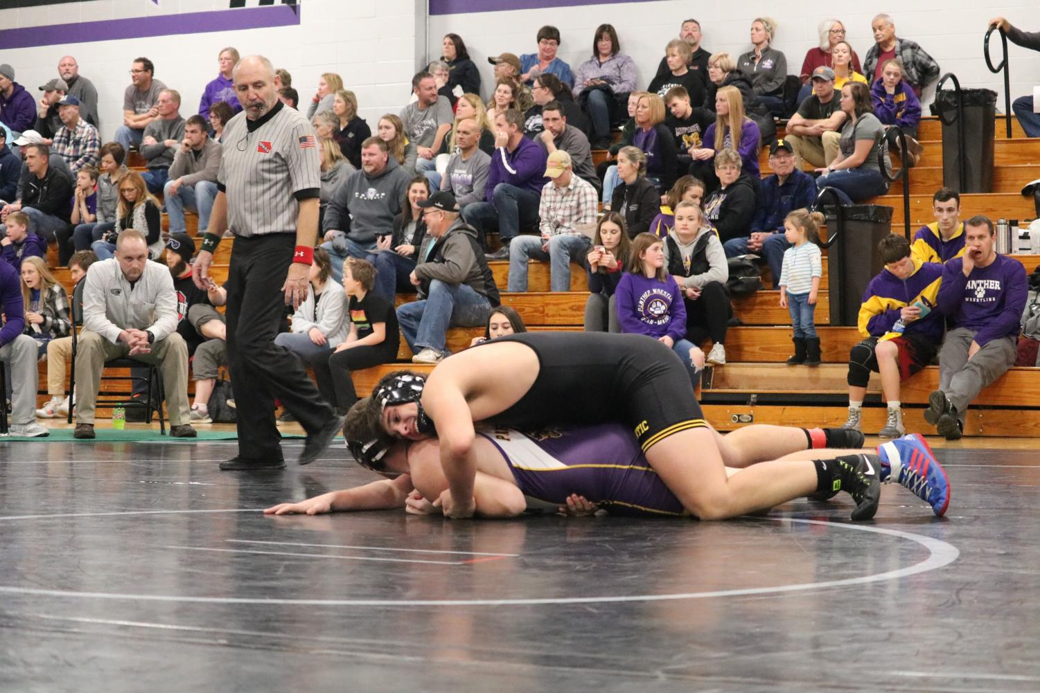 Senior Cale Roller lays on top of his opponent in one of the duals last year. Roller has been on the varsity squad since his freshman year.