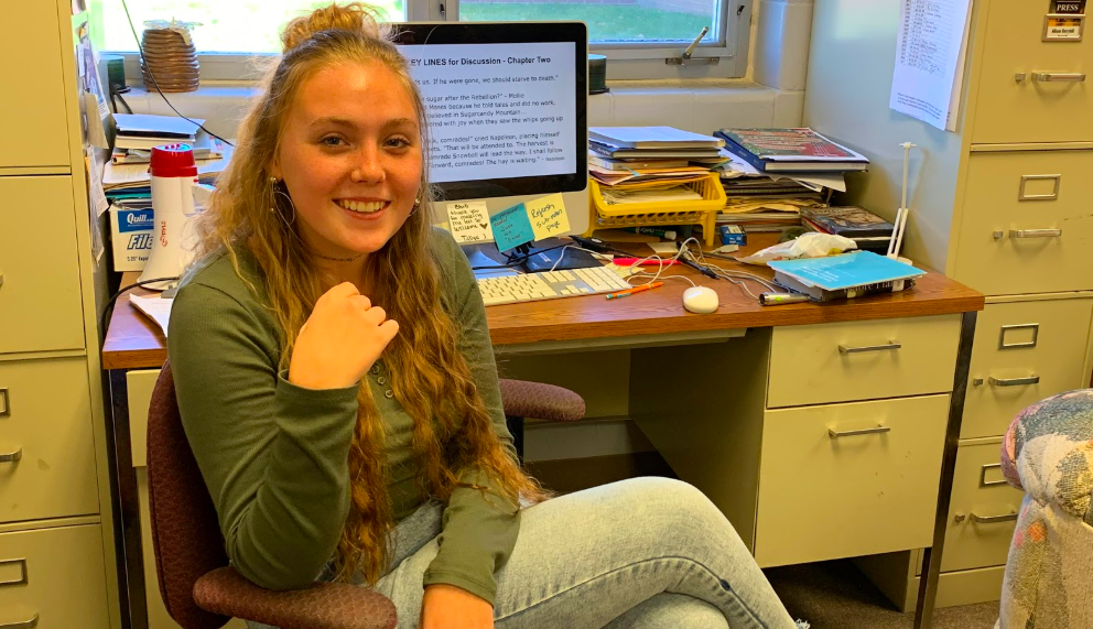 """Teacher's aide Aly Brockob sits and listens in on the English 1 Honors class. Brockob enjoyed observing a classroom, as it was a """"different environment"""" compared to participating."""