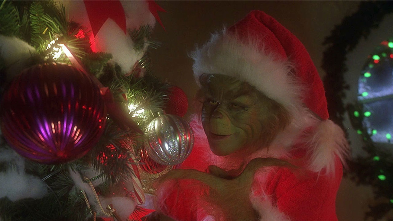 The Grinch stealing Christmas from the little ones in Whoville.