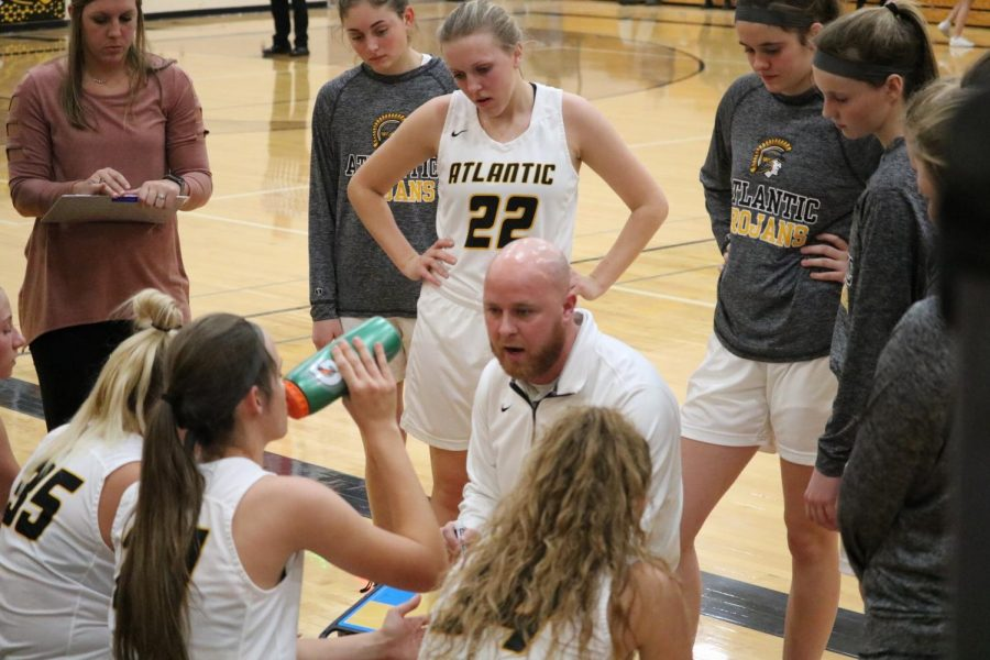 Coach Dan Vargason goes over the game plan on Tuesday night. The girls played a monstrous game, hitting five three pointers.