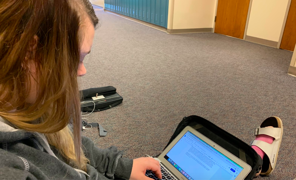 Editor Camryn Church finishes a news brief for the website. Church is a part of the third-period editing class that works in the hallway.