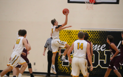 Trojan Boys Basketball Drops First Game of Season