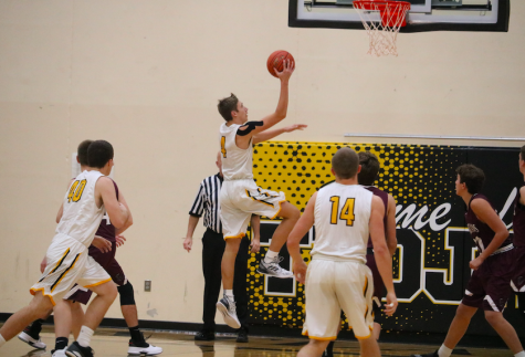 Trojan Boys Basketball Drops First Game of Season