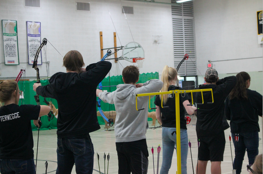Archers prepare to shoot their arrows. The archery team is comprised of middle and high schoolers.