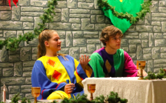 Seniors Belle Wickman and Bradley Dennis pop a squat at last year's Madrigal Dinner. The two were jesters their junior year.