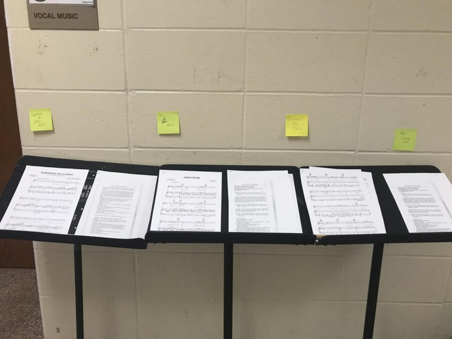 The audition materials sit outside the choir room, waiting for courageous individuals to snatch them. Those auditioning have to sing and act.