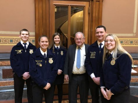 Juniors Craig Alan Becker, Taylor McCreedy, and Alyssa Derby, and seniors Tate Den Beste and Corri Pelzer stand with state senator Tom Shipley. The FFA members got the chance to chat with Shipley on Tuesday in Des Moines.