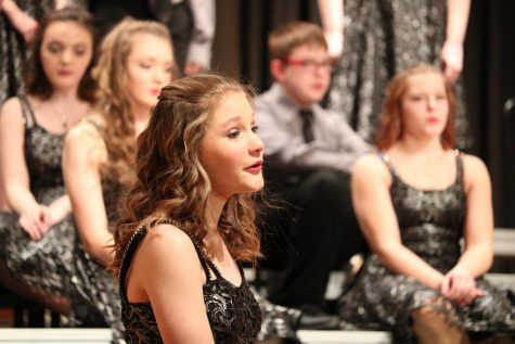 Sophomore Katy Rothfusz sings along to the ballad. Last year, Rothfusz was a part of the Diversity show choir, but this year she is in Premiere.