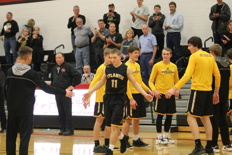 Junior Craig Alan Becker shakes hands with his teammates during the team introductions. Becker averages 5.7 points per game.
