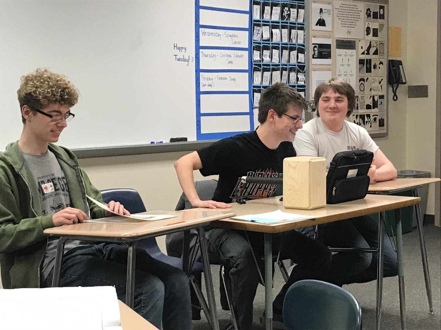 Freshman Weston Hoover sits next to two of game club's founders, juniors Devlyne Sunderman and Lane Muell. AHS' newest addition had been brewing since May 2019.