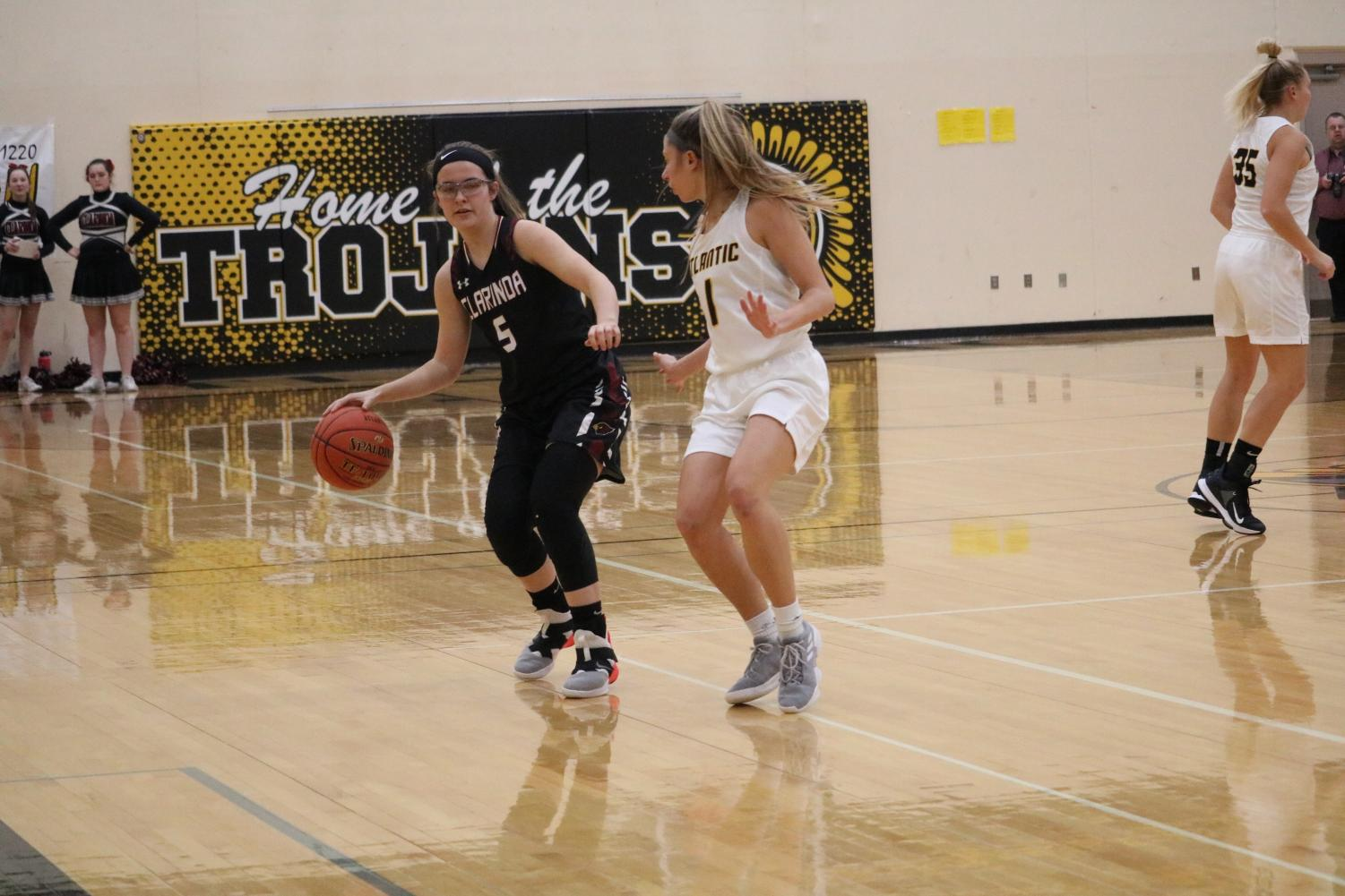 Junior Haley Rasmussen guards her girl in a game earlier this season. Rasmussen has played varsity basketball since her freshman year.