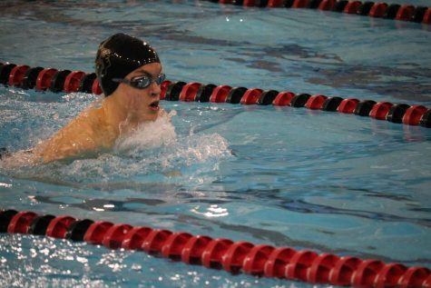 Sophomore Drew Engler cuts through the water during his event. Engler took fourth place in the 100-yard breaststroke.