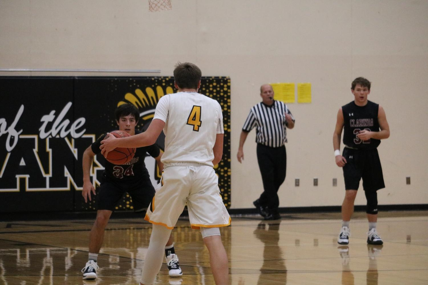 Junior Skyler Handlos waits for a play to open up on the home court. Handlos leads the team in scoring, averaging 16.8 points per game.