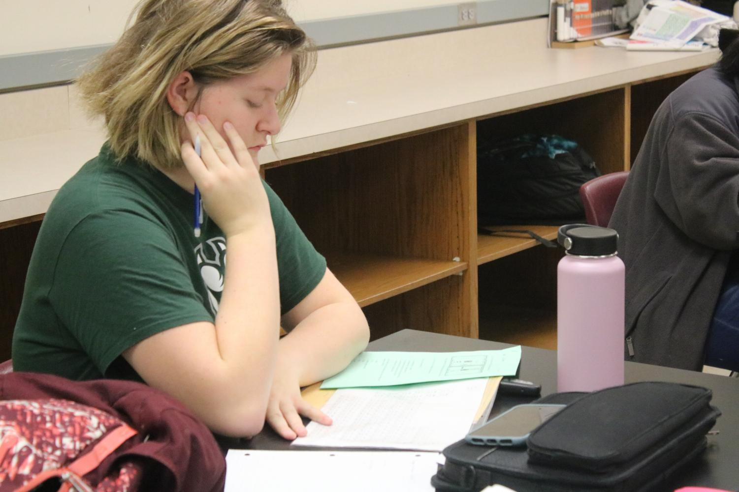 Junior Reagan Watson studies for chemistry during AO time. Many students use the assigned slot of time to ask questions in classes they need help in.