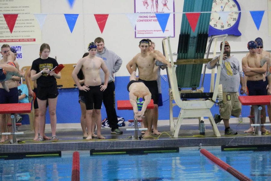 Sophomore+Brayden+Atkinson+dives+into+the+water+at+the+start+of+a+relay+race.+Atkinson+won+two+events+on+Thursday.