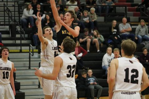 Junior Skyler Handlos goes in for a layup. He leads the team in scoring, averaging 16.9 points per game.