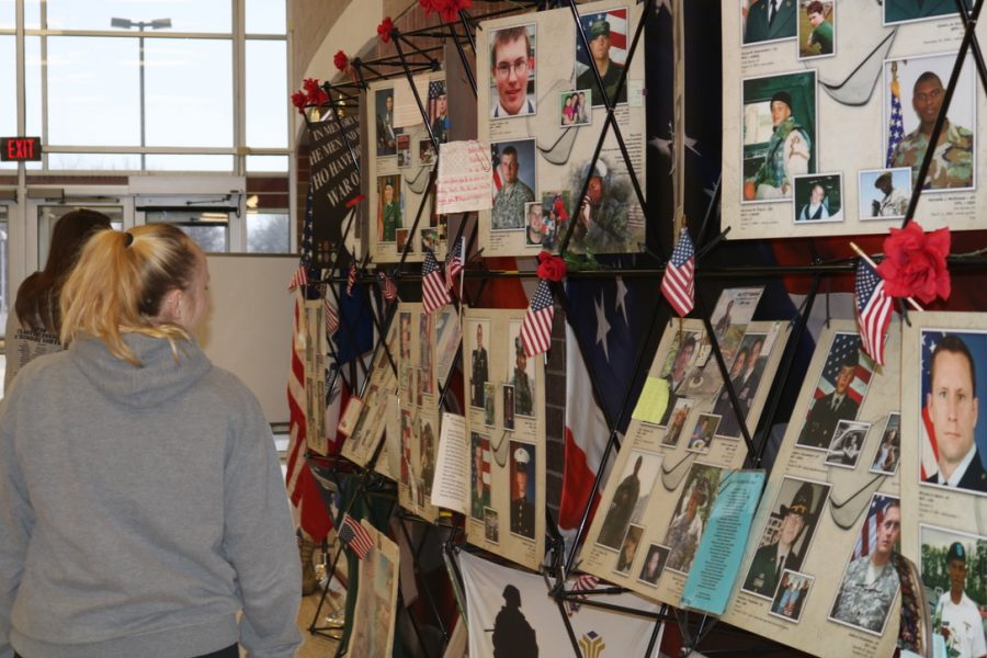 NOT FORGOTTEN - Photographs and mementos telling the stories of Iowa veterans lined the entry of AHS last week.