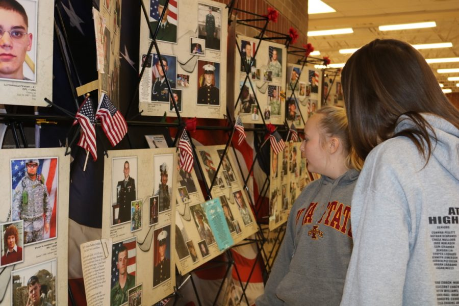 PAUSE AND REFLECT - Sophomore Trista Flathers uses study hall time to read about fallen Iowa soldiers. The display was brought to AHS by Camblin Mechanical.
