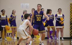Junior Grant Sturm scopes out the floor for an open teammate. Sturm ended the season with an average of 7.5 points and 3.4 rebounds per game.