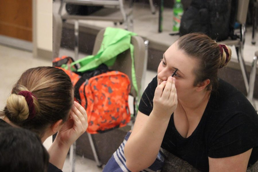 Junior Camryn Church fills in her eyebrows before this year's fall play. Applying makeup before going on stage is a common practice for those involved in the arts.