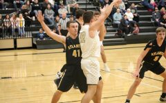 Senior Nile Petersen plays tough defense. On Monday night, Petersen had seven rebounds and five points.