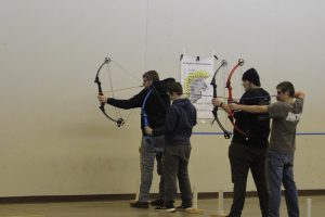 Twin brothers Derek and Dustin Dreager shoot with senior McCade Stillian and junior Zach Colton at archery practice. The Dreager boys have been involved with archery throughout high school.