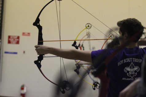 Junior Joe Sonntag prepares to shoot his bow at archery practice. Sonntag shot a 265 at the Nodaway Valley meet.