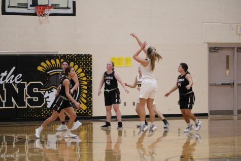 Junior Haley Rasmussen goes for three against the Cardinals. On Saturday night, Rasmussen hit three three-pointers.