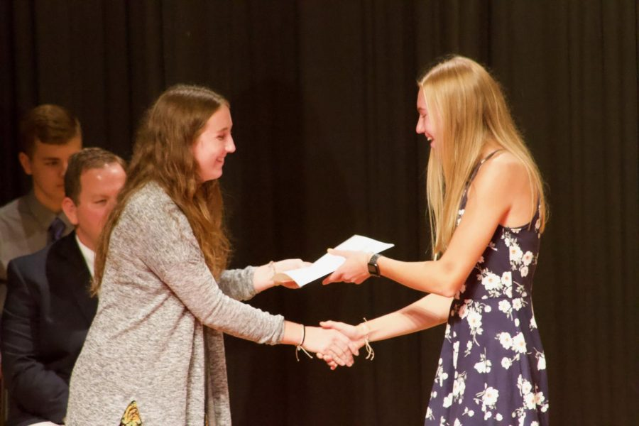 NHS Vice President Katie Saluk awards new-inductee Maddie Botos her certificate. The Crush-O-Gram activity is put on by Atlantic's NHS chapter.
