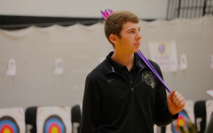 Sophomore Cooper Jipsen carries his arrows at this season's home tournament. Jipsen shot a 296 at the Creston tournament this past weekend.