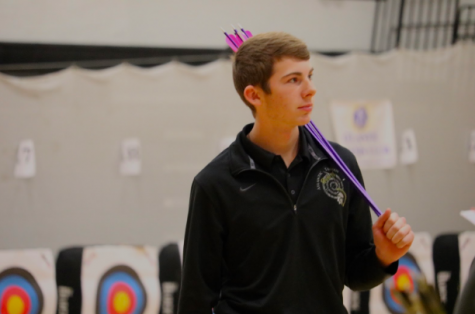 Sophomore Cooper Jipsen carries his arrows at this season