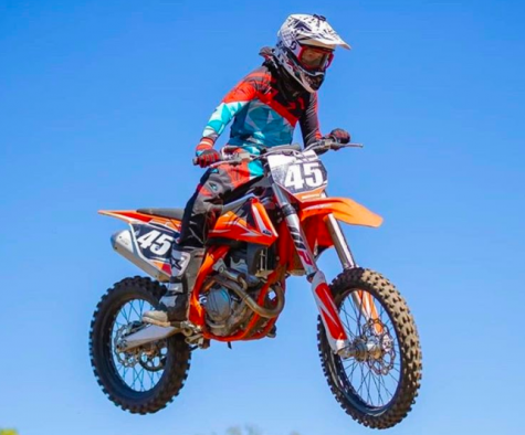 Freshman Zane Brownsberger flies through the air on his dirt bike. The latest competition he attended was in Council Bluffs.
