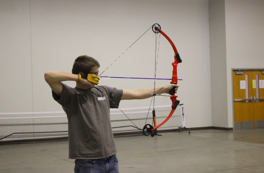 Senior+Dustin+Dreager+prepares+his+shot.+Dreager+has+been+involved+with+archery+all+four+years+of+high+school.