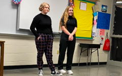 Junior Molly McFadden and senior Aly Brockob prepare to perform at District speech.