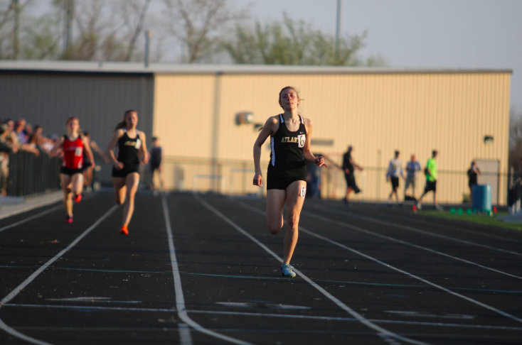 Junior Haley Rasmussen sprints down the track during the 2018-19 seasons. The track season began on Monday, Feb. 17 for students not involved in a winter sport.