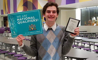 Junior Troy Roach poses with his plaque after qualifying for the National speech and debate tournament. Roach attended the tournament last year along with 2019 grad Sarah Schorle and junior Genevieve Martinez.