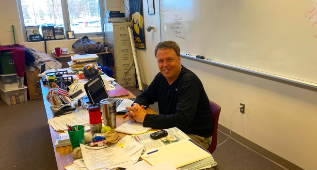 History teacher Trace Petersen sits at his desk during class. On a survey sent out to all students, Petersen had the most-known sayings.