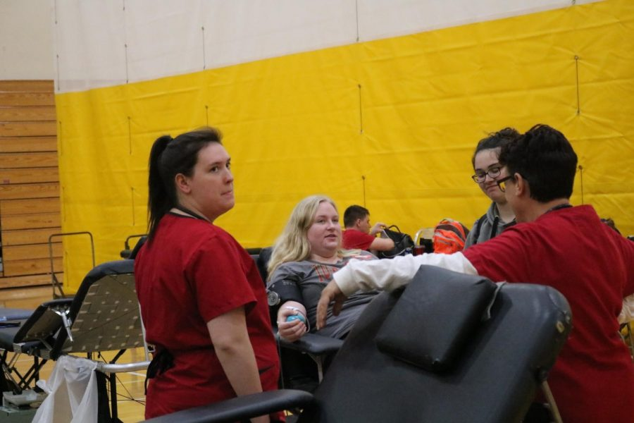 Senior Bethaney Meurer donates blood during the last blood drive. Donators should consider drinking lots of water before they give blood.
