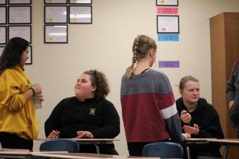 A group of freshmen work together during Drama class. Speech coach Alex Bales teaches the course.