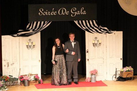 "Senior Erin Barrick and Joel Behrens pose at Grand March last year. The theme for Prom 2019 was ""A Night in Europe."""