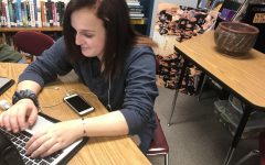 Sophomore Taliya James works during class. James wears her signature accent item on her left wrist.