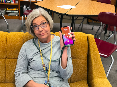 Adviser Allison Berryhill showcases yet another spam phone call during class. Callers can spoof phone numbers to appear like they are coming from in town.