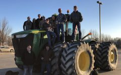 The ten boys who participated in Tractor Day pose with one of their sick rides. Tractor Day is an annual event.