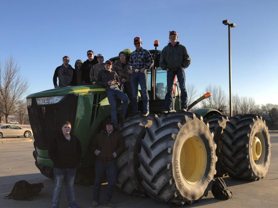 The+ten+boys+who+participated+in+Tractor+Day+pose+with+one+of+their+sick+rides.+Tractor+Day+is+an+annual+event.