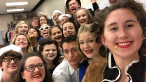 Cast members pose for a selfie before the 2019 musical