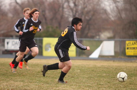 Junior Keagan Garcia drives forward with the soccer ball. Garcia has played soccer since his freshman year.