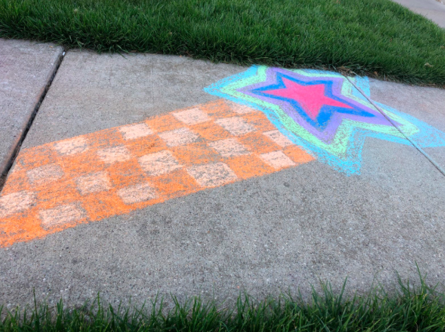 Senior+Kylie+Neal+decorated+her+driveway+and+sidewalk+with+chalk.+Neal+noticed+other+posts+on+Facebook+showcasing+sidewalk+art.
