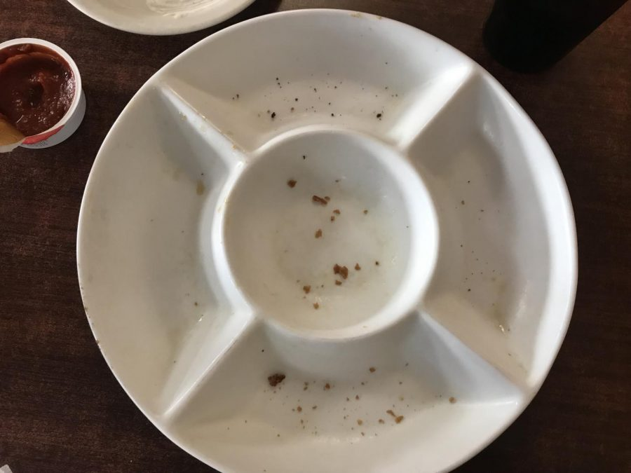 A clean plate and an opened ketchup packet was all that was left after we visited our first location in the appetizer journey.